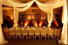 Beautiful draping and low candle light create a very romantic and comforting appeal to any reception.