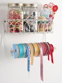 Holiday ribbons in a mess? A paper towel holder makes a great storage system! More smart storage solutions: http://www.bhg.com/decorating/storage/craft-room/craft-storage-containers/?socsrc=bhgpin112812ribbonholder
