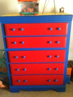 Boys Dresser... Take an old dresser sand it down then paint it when thats done get wooden knobs from home depot and paint them in one of your colors the whole project ran us 20 dollars