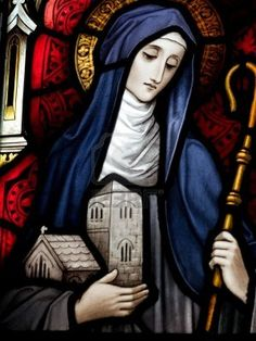 Stained glass in a Catholic church in Dublin showing Saint Brigid of Kildare. The stained-glass windows are by the famous artist, William Early, who died during the commission.