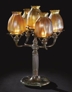 TIFFANY STUDIOS  FIVE-LIGHT CANDELABRUM / c. 1910 / favrile glass and patinated bronze / so gorgeous...
