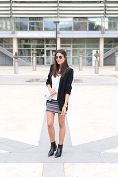 Federica L. is looking super cool in this awesome monochrome style, consisting of a plain white graphic tee, an aztec print skirt, and a classic black blazer with shoulder padding for an enhanced silhouette. Jacket: Zara, Top/Skirt: Zara.