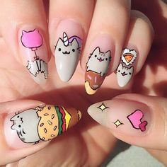Wow! Check out this amazing Pusheen nail art by @i_heart_nailart