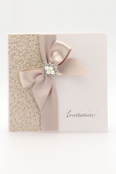 Pebble pocket fold invitation is a elegant embossed design crafted from luxury pearlised papers, can be finished with soft satin ribbon/ and bespoke jewels.
