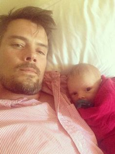 """The new dad glowed in an Instagram picture with son Axl on Oct. 6, 2013. He captioned the shot, """"Gonna catch some football with my little guy today."""" Umm, adorable! RELATED: Josh Duhamel cuddles up to baby boy Axl to watch football"""