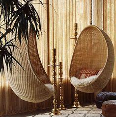 Indoor, comfy wicker swings.