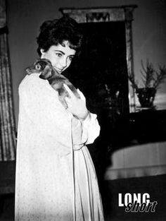Elizabeth Taylor and her dachshund -and our dachshund is named Elizabeth Taylor! funny!