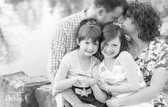 Family of four pose idea two sisters, two daughters with mom and dad antioch park in merriam Kansas by Darbi G Photography