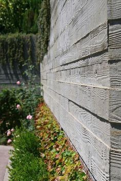 Mom, what do you think about using this look for the concrete retaining wall around the southeast outdoor patio? Using boards for the concrete form work is a direct reference back to the barn. If you look at the barn's foundation you will see board marks similar to this. Another thought it to clad these walls in stone, but this may be too expensive.