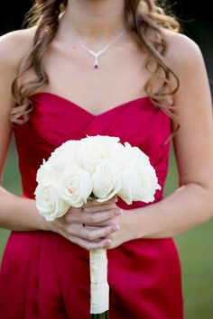 My bridesmaid has knee length sweetheart red dresses, with ivory roses. the roses had rhinestones inside.  Wrapped with ivory ribbon.  Ruby Necklace and earrings