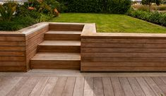 This could work with raised planter boxes extending back along the fence on the left. Build in a bench on the right side of the stairs or keep the retaining wall low enough to sit on? Backyard Retaining Walls, Concrete Retaining Walls, Retaining Wall Design, Building A Retaining Wall, Poured Concrete, Sloped Backyard Landscaping, Sloped Yard, Landscaping Ideas, Backyard Ideas