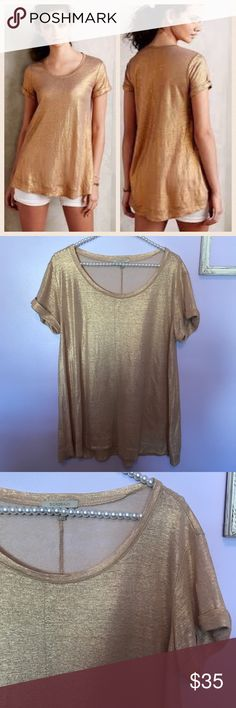 "Anthro Bordeaux Metallic Gold Blouse Top Excellent condition. Size PETITE XS but could fit a regular small. Runs big- see measurements. Semi sheer so best with a cami or bralette underneath. Rolled sleeves. Metallic Gold.  Measurements when flat:  Armpit to armpit- 21"" Length- 28.5"" 🙅🏻No trades! 💗Offers through the offer button only 📦Bundle and save 20% off your order Anthropologie Tops Tees - Short Sleeve"