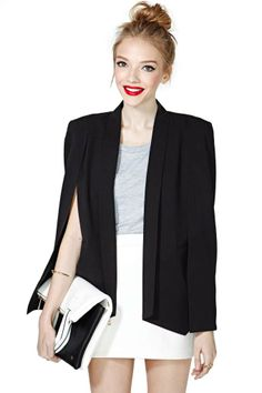 Truly is a charmer. this versatile cape/blazer looks like is can become a classic, for business. I love it !!!!!!