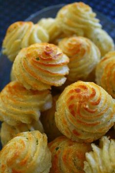 Duchess potatoes look fancy, but they are surprisingly easy to make. Just stir egg yolks, butter, cream, plenty of salt and pepper, and a dash of nutmeg into mashed potatoes, then pile the mixture into a pastry bag and pipe it onto a baking sheet in any shape you like. Sprinkle with a little shredded cheese, bake, and you'll have an elegant potato side dish for your next dinner party.