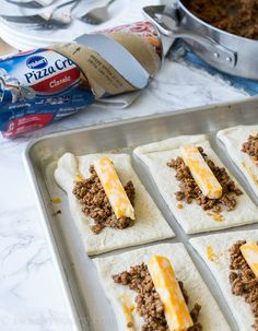 These super simple Cheesy Taco Sticks are buttery breadsticks filled with taco meat and lots of cheese! Perfect for snacking or watching the big game!