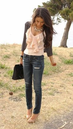Distressed jeans and ruffled blouse