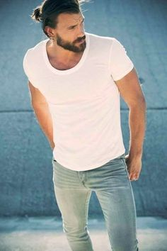 Pairing a white crew-neck tee with light blue slim jeans is a comfortable option for running errands in the city.