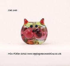 Lampwork Glass Cat 140. £9.00, via Etsy.