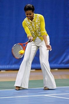 Michelle Obama playing tennis!! Looking so stylish too in L'Wren Scott Spring 2012 Collection