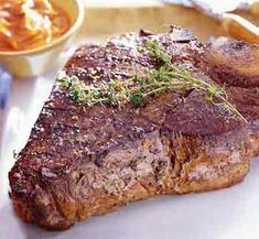 Grilled Porterhouse Steak with Paprika-Parmesan Sauce.  This was one of the best steaks I have ever had.
