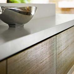Poggenpohl teak quartz cabinet doors, wonderfully tactile dragged resin surface. #poggenpohl #kitchen #custommade