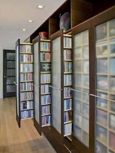 compact CD library storage: my Dad had similar roll-out storage containers on casters that he custom built for his garage in Florida, storing all his tools and materials behind neatly closed doors.