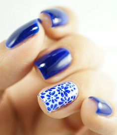 Rina Alcantara of Simply Rins was inspired by porcelain for this delicate accent nail. Use a small brush to free-hand a cluster of small flowers on your finger of choice, and paint the rest of your nails in the same royal blue.  - GoodHousekeeping.com