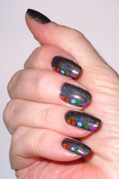 Inspired from a Pintrest nail art, simple Color Club black holo polish and dots made with acrylic paint.