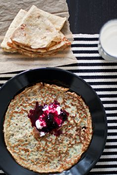 Swedish pancakes with black currant jam and whipped cream.
