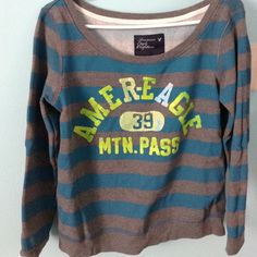 AE Sweater Top Teal and dark grey stripes with yellow lettering. Very warm, it's kept me going for a few years; but now it just sits. American Eagle Outfitters Sweaters