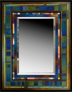 Jazz II by Thomas Meyers. Hand cut glass piece are precisely assembled to create exquisite glass mosaic. The *iridescent:iridized glass* glass changes color with lighting conditions. Some of the glass pieces are drawn on by the artist with a kiln fired *vitreous* paint to establish the character of each unique mirror frame. Can hang either vertically or horizontally. Signed on back. Dimensions refer to the overall size of the piece. Mirror size is 18