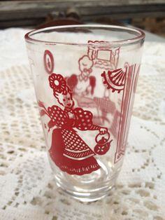 Fancy  Vintage SWANKY SWIG us Era Juice Glass with Red Lady Design