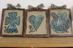 Faith, Hope, Love set of 3 8x10 canvases with a cross, an angel, and a heart rustic. $45.00, via Etsy.