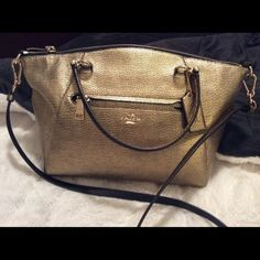 """Coach 36325 PRAIRIE SATCHEL Coach 36325 PRAIRIE SATCHEL IN PEBBLE LEATHER handbag Metallic Gold Polished pebble leather Inside open multifunction pocket Zip-top closure, fabric lining  Dual handles with a drop of about 5"""".  Detachable longer strap with 21.5"""" drop for shoulder wear   Measures approximately 12"""" (L) x 9"""" (H) x 3 1/2"""" (W) one front zip pocket This was a display and there are some faint scratches. Coach Bags Satchels"""