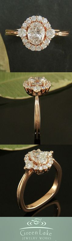 Oval halo engagement ring with accent diamonds. Probably the most beautiful ring I have ever seen.