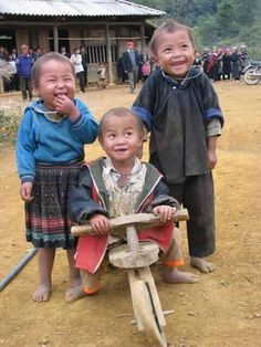 3 wise souls! isnt it amazing how happiness has nothing to do with material wealth! ..luv his had made bycycle :)