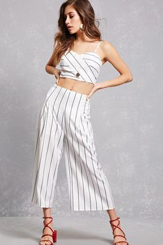 A woven set featuring an allover pinstripe design, a crop top with a sweetheart neckline, an asymmetrical designed front, adjustable cami straps, and a back zip closure, as well as a pair of culotte-style wide leg pants with a high waist, and a concealed back zip closure.<p>- This is an independent brand and not a Forever 21 branded item.</p>