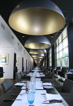 Kullmann Lighting & Interior Exclusieve lamp boven eetkamertafel