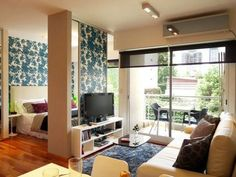 How to Use a TV as a Room Divider - make it swivel so you can watch it in the living room AND the bedroom