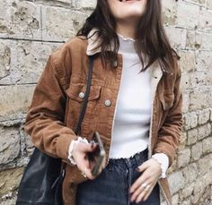 Beige jacket with knit sweater and blue jeans. Winter outfit idea.