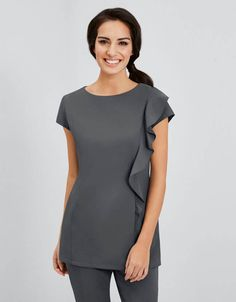 Combining a fashion-forward flair with practical style and comfort, our modern Scooped Angle Neckline Tunic is available in seven core colour styles. For ease of movement and flexibility in the workplace, our designers have added a double action back, together with dart sleeves as well as an invisible centre back zip fastening. Look bang-on-trend and complete the look, by pairing our tunic with a Decorative Patterned Sash and Slim Leg Trousers!