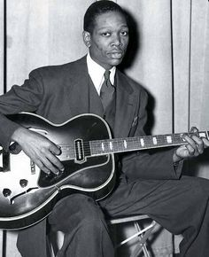 Charlie Christian. Perhaps the first to electrify his guitar, bringing the instrument out of the background in a jazz band.