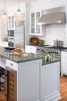 Kitchen With Antique White Glazed Cabinets Cinder Caesarstone - Calcutta kitchens