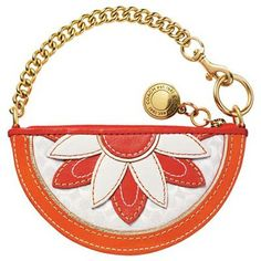 How cute is this? The new Coach Orange Flower Coin Purse is absolutely darling, showing off vibrant hues of orange and contrasting white. It's a sunny little bag boasting warm weather appeal and infused with charm. From the luxe leather and suede floral design to the gold-tone, dog leash chain strap, this Coach purse offers plenty of reasons to fall head over heels in love!