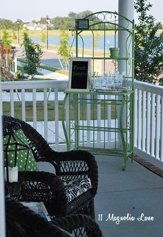 Porch with bar from repurposed baker's rack--great idea!