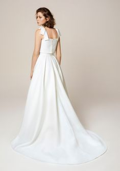 0e6896a32d6 Bow shoulder detail bridal separate fop and flowing skirt. The Perfect Gown  For Your Wedding
