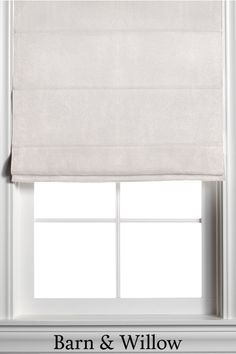 Roman Shade in a neutral beige color. Made of velvet, this custom window shade is hand-stitched by expert hands and adds a touch of texture and style to any room. Custom Roman Shades, Custom Windows, Beige Color, Window Coverings, New Homes, Velvet, Hands, Curtains, Touch