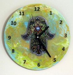 The Chosen Time ~ Products ~ Hamsa Clock. Painted Judaica Clock on recycled LP. One of a Kind Art # ~ Shopify Clock Painting, Hamsa, Egyptian, Lp, Art Pieces, Recycling, Crafts, Products, Manualidades