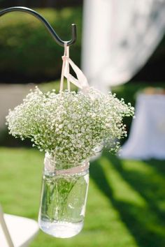 Baby's breath in a jar. Adorable baby shower decoration!