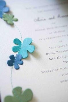 Stitched flowers on a menu or invitation.